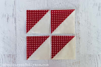 four red and cream half square triangles