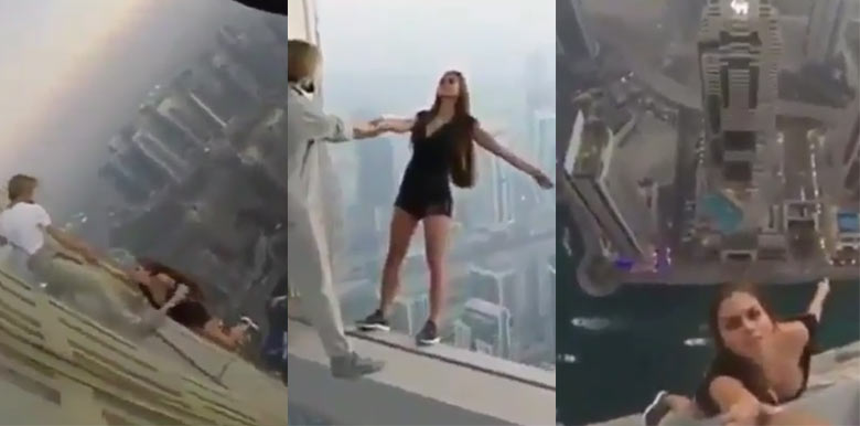 Viewer discretion: Watch two dare-devil stunters take risky pictures on very tall building
