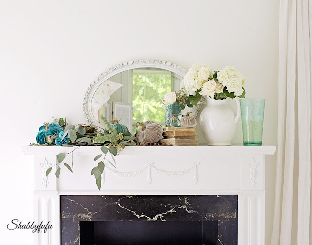fall mantel with aqua velvet pumpkins