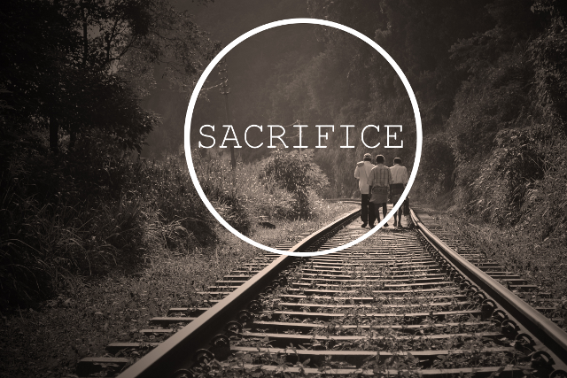 Three Men Walking Down A Rail Road Track Together With The Word Sacrifice Written On It