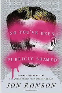 Book cover, 'So You've Been Publicly Shamed' by Jon Ronson. Image depicts an old-fashioned image of a man's face, the letters of the title superimposed over pink graffiti smears across the eyes and mouth of the man's face.