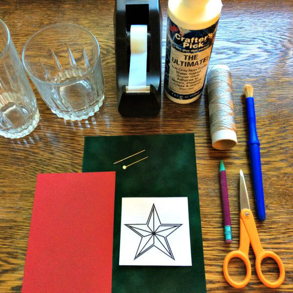 supplies for making a paper stitched star ornament
