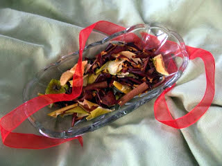 Dry the fruit and make up a batch of homemade simmering potpourri to give as gifts