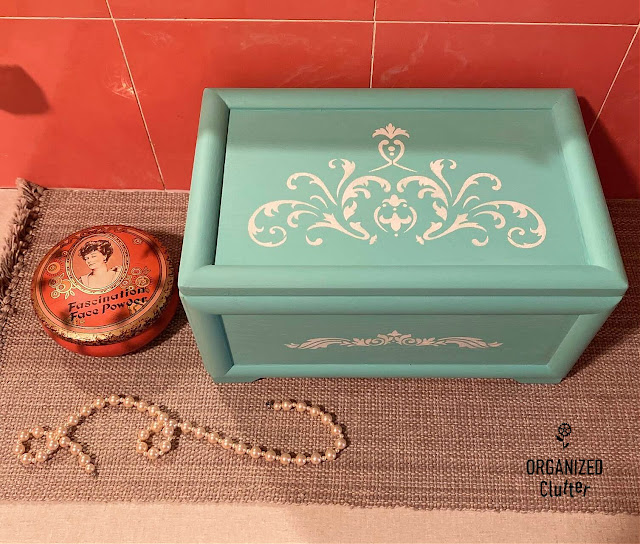 Photo of an upcycled jewelry box on the bathroom vanity