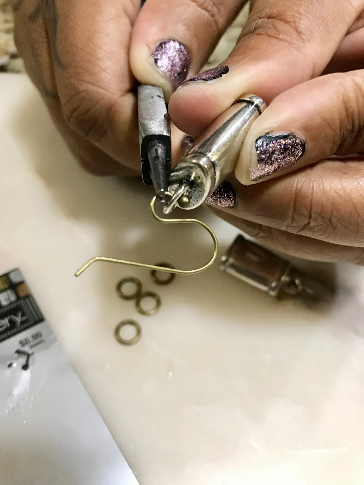 Image: Tangie Bell uses end caps and ear hooks to make earrings for a quick date night