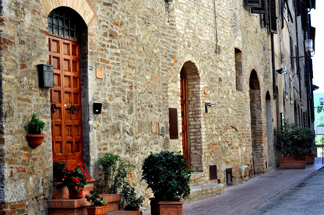 Wooden Doors along a Street in San Gimignano, Italy | Taste As You Go