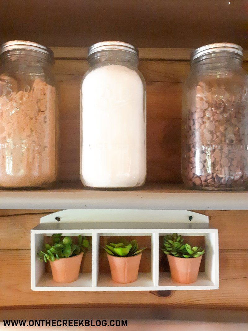 A small shelf gets a white chippy makeover with chalk paint!   On The Creek Blog