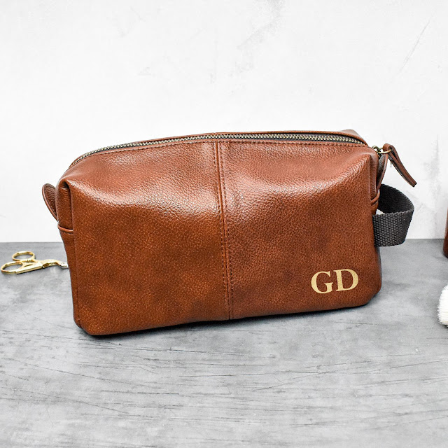 Brown washbag with gold foil initials