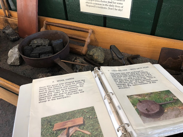 Hands-on discovery table introducing iron production and village life at Hopewell Furnace in Pennsylvania