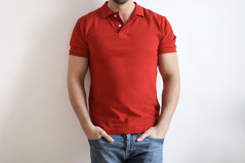 A man wearing red colour polo t-shirt.