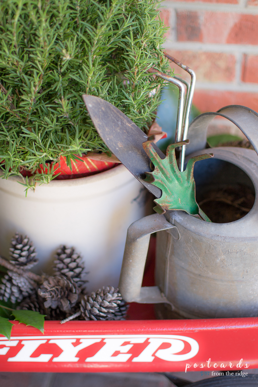vintage watering can and gardening tools