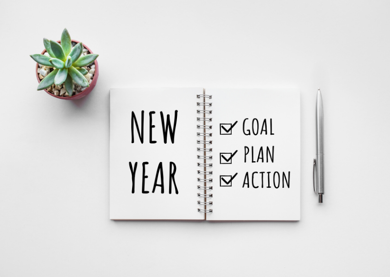 A diary with new year written on it and a list of things to achieve that year