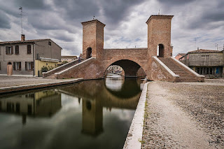 The bridge known as Trepponti is an unusual architectural feature in Comacchio