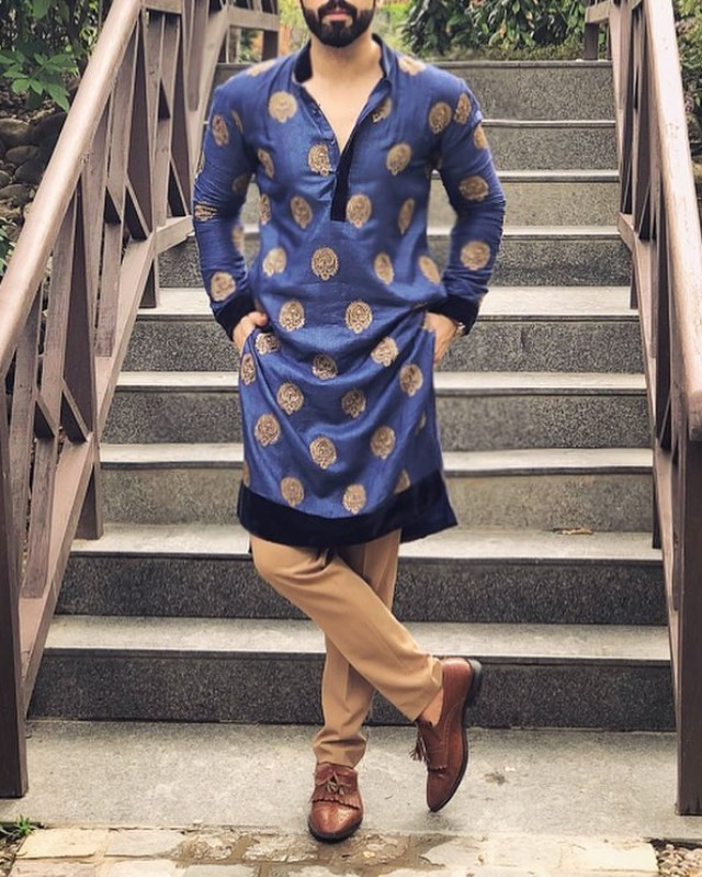 A man in colour pattern kurta-pyjama and loafers
