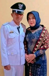 Kepala Pekon Tulung Asahan Bapak Rusli didampingi istri