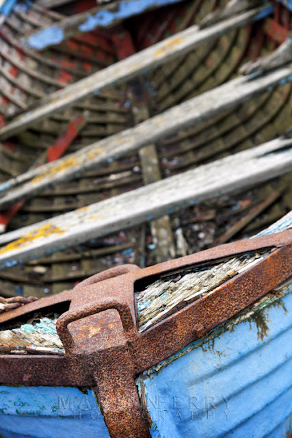 Detail shot of old rowing boat at Holy Island, Northumberland by Martyn Ferry Photography