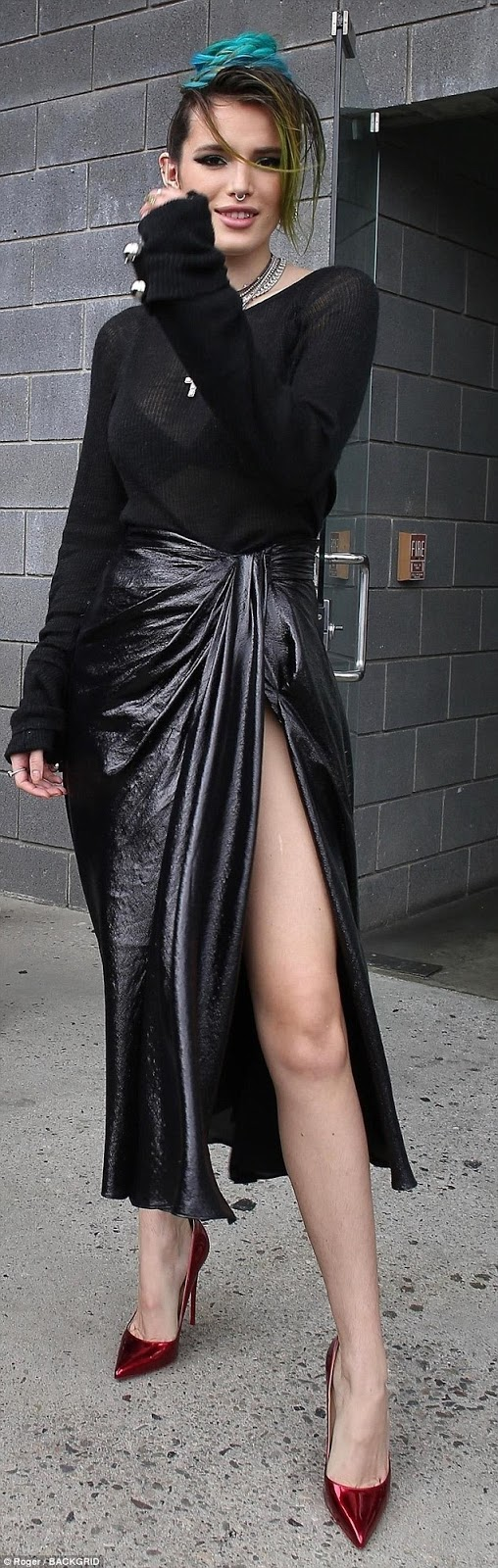 """Bella Thorne channels Madonna as she flashes her legs in a high-slit black skirt while out promoting """"I Still See You"""""""
