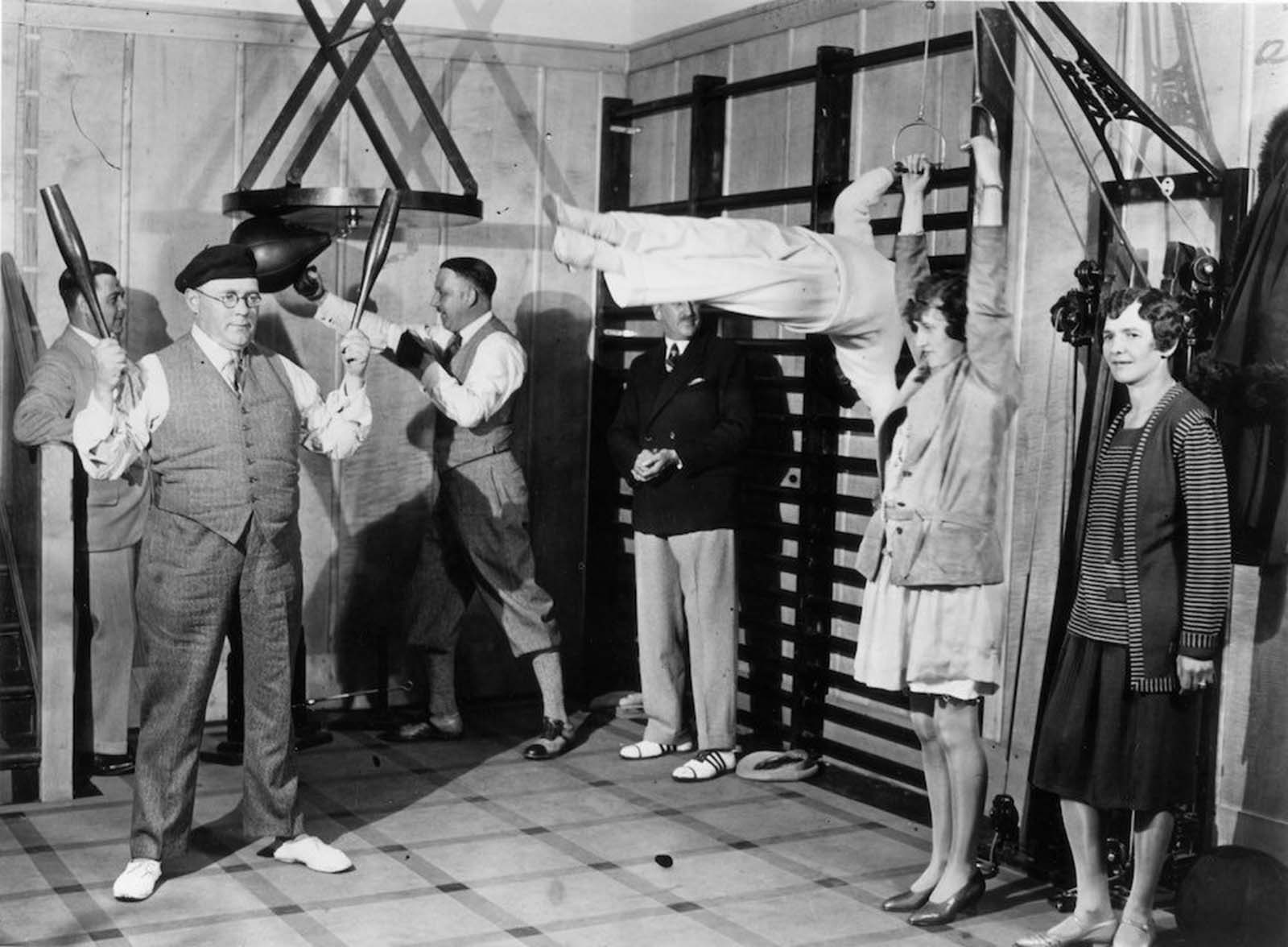 Passengers on the Canadian Pacific liner Duchess of Bedford keep fit in the ship's gymnasium. Dec, 1931.