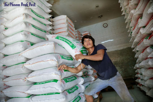 A worker stacks sacks of rice in Phnom Penh earlier this year. Hong Menea