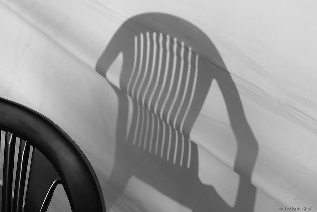 A Series of 3 Black and White Minimalist Photographs of a Plastic Chair and its shadow captured at Jawahar Kala Kendra, Jaipur, India.