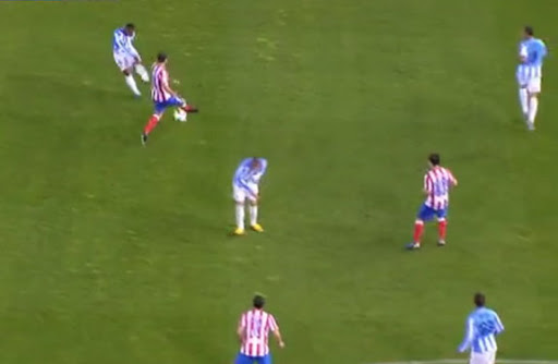 Málaga player Eliseu shoots to score from long range against Atlético Madrid