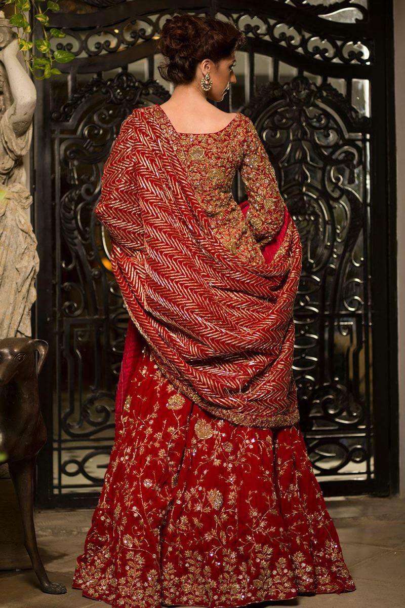 Red color beautiful heavily embroidered gown by Nida Azwer bridal dresses for reception
