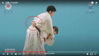 Picture of the start of the Judo Throw O-Goshi with Tori's hand around the back of Uke (circled in red emphasizing that the belt is not being gripped).