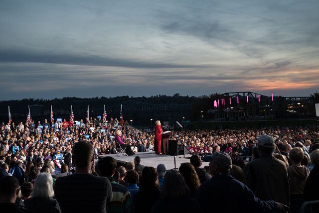 image of Hillary Clinton speaking to a large crowd in Cincinnati outdoors at dusk