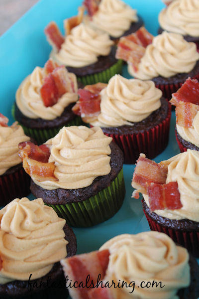 Chocolate Cupcakes with Dulce de Leche Buttercream and Candied Bacon // Moist chocolate cupcakes with light and airy caramel frosting and a candied bacon garnish #recipe #chocolate #bacon #dulcedeleche #cupcakes #Choctoberfest