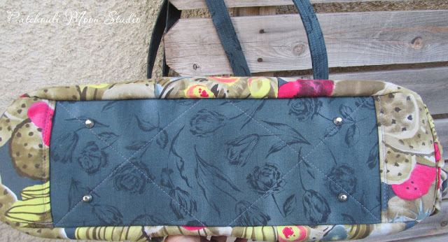 Bottom of the yoga bag that is quilted and has purse feet added.