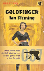 Gold book cover featuring image of spy, gun and glamorous woman