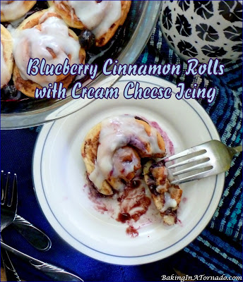 Blueberry Cinnamon Rolls with Cream Cheese Icing. Start with refrigerated cinnamon rolls, add fresh blueberries and cream cheese icing for a sweet breakfast treat.   Recipe developed by www.BakingInATornado.com   #recipe #breakfast