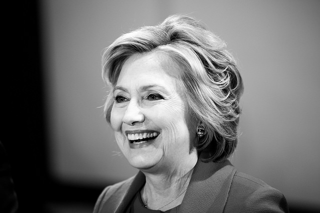black and white image of Hillary Clinton on the campaign trail, smiling broadly