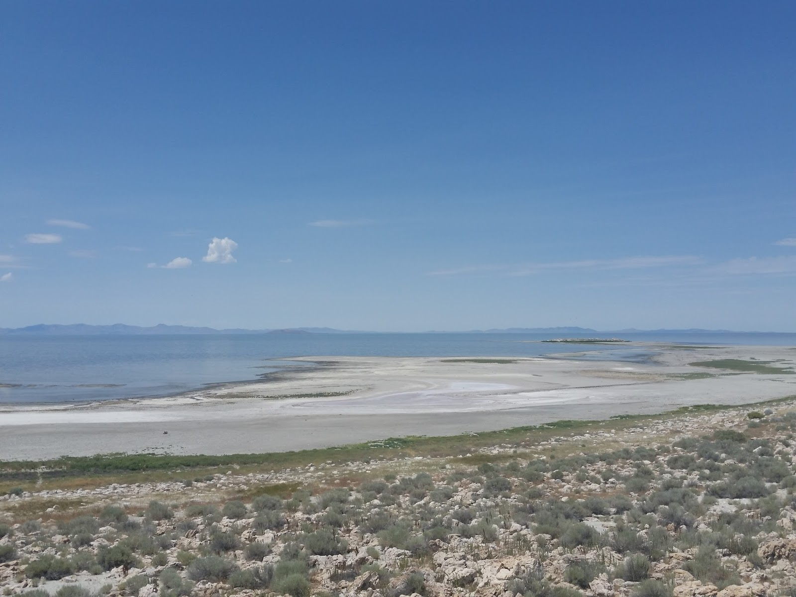 You could see the vast Great Salt Lake from both sides; both of us in awe  at the white salt beaches. There was an entrance booth to collect our fee  of $10 ...