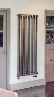 Classic tall column radiator in bare metal