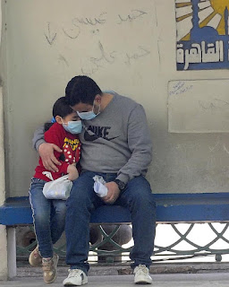 "A father and a daughter in a Cairo bus stop  ""Mohamed Shokry"""