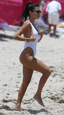 Kourtney Kardashian flaunts her toned figure in a high cut swimsuit on a beach in Miami (photos)