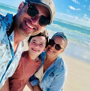 Amanda Moye Brown clicking selfie with her hubby & daughter