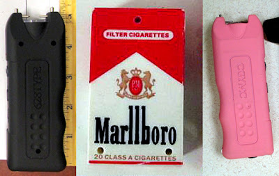 (L-R) Black Stun Gun (MDW), Stun Gun Disguised as Pack of Ciggaretts (CLE), Pink Stun Gun (AZO)