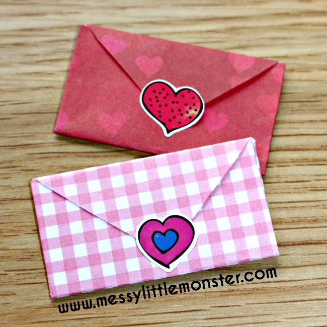 Origami paper craft for kids.  Tiny folded heart envelopes with secret love letters inside.  Free printable.