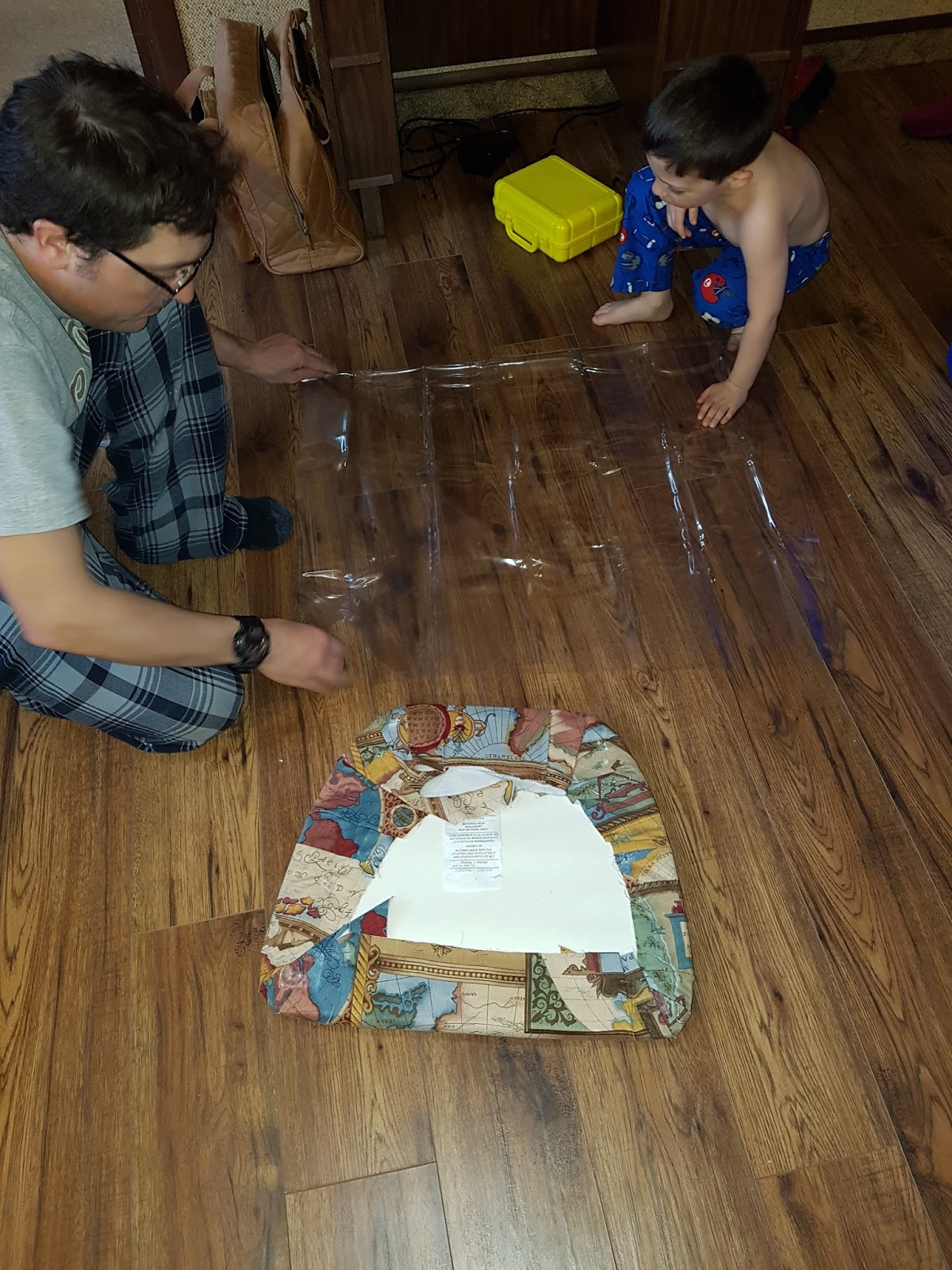 Family Buzz: Covering kitchen chairs in clear plastic