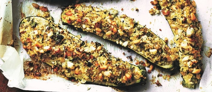 Close up of Stuffed Courgettes with Bulgur Wheat and Preserved Lemon on baking tray