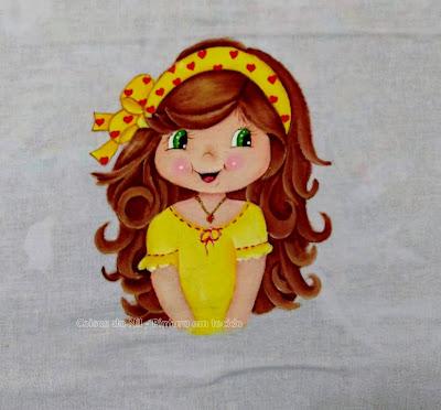 pintura boneca Moranguinho com faixa no cabelo.