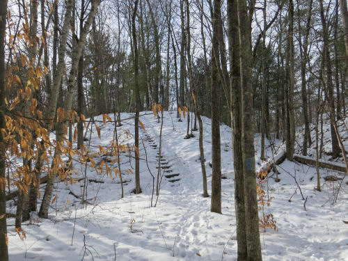 steps on a snowy hill