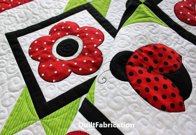 Ladybugs and flowers quilt by QuiltFabrication