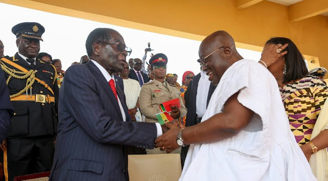 President Akufo-Addo of Ghana (R) and President Robert Mugabe of Zimbabwe (L)