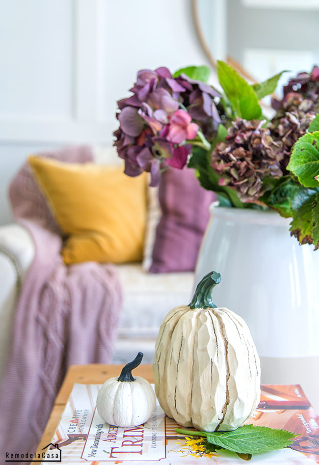 Living room Fall decor with mustard yellow, plum and a dash of blue.