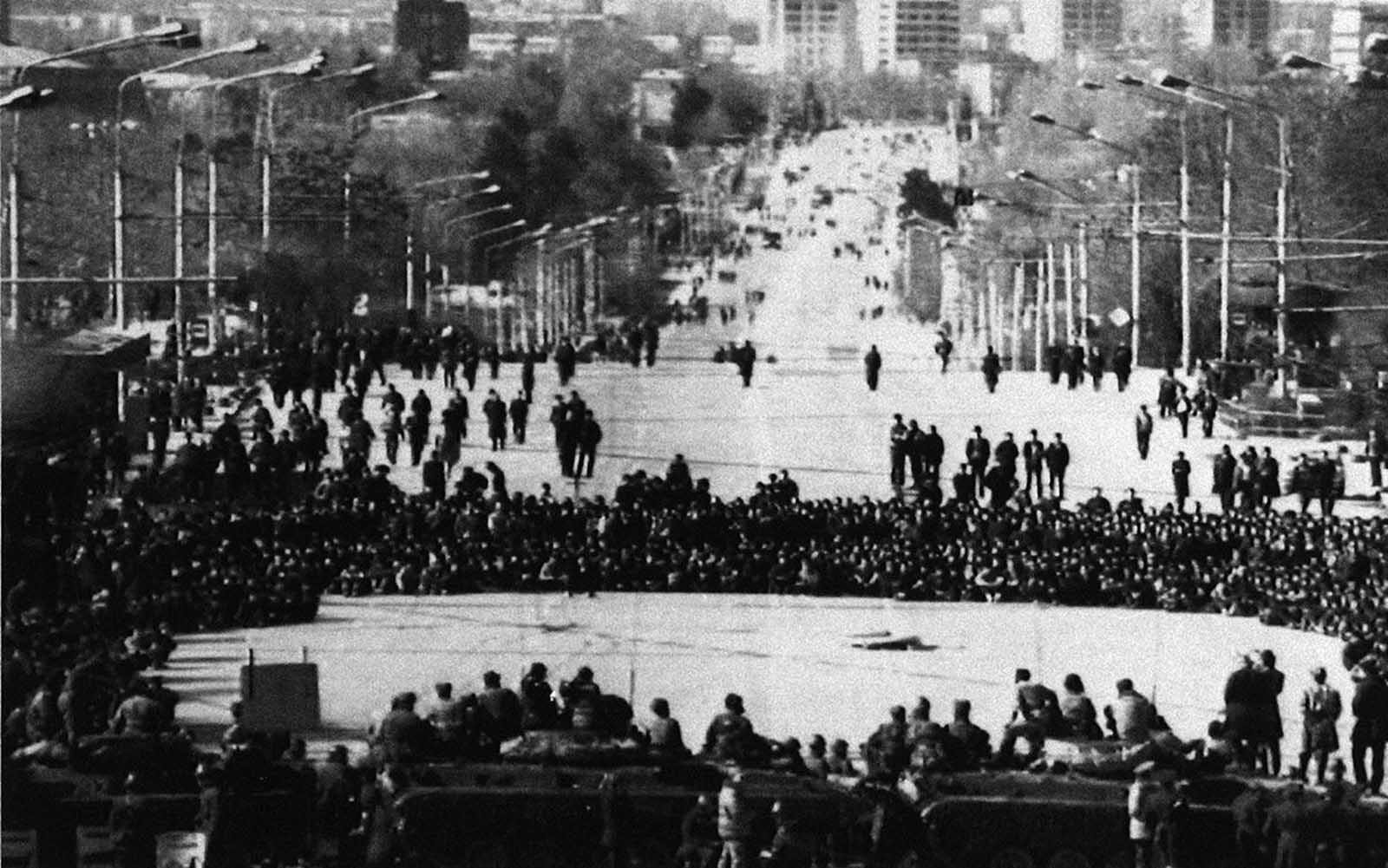 Residents face a cordon of Soviet Interior Ministry troops in front of the local Communist Party Headquarters in the Tajikistan capital of Dushanbe, on February 15, 1990. Soviet authorities declared a state of emergency in the city, following ethnic rioting.