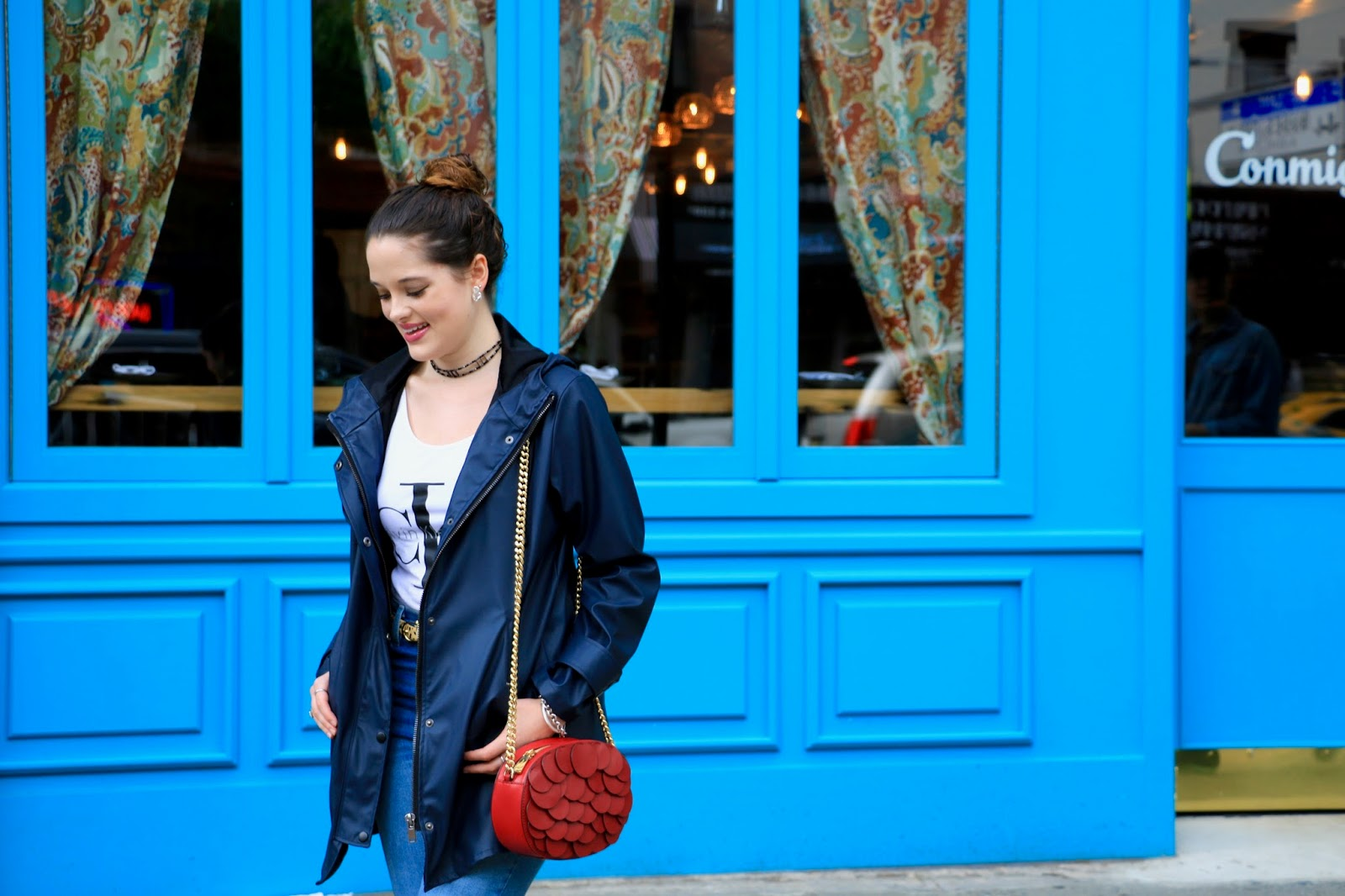 Fashion blogger Kathleen Harper of Kat's Fashion Fix wearing navy rain jacket