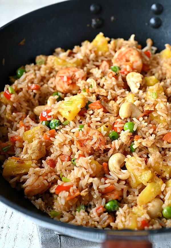 thai pineapple fried rice in a wok with shrimp,eggs and cashews